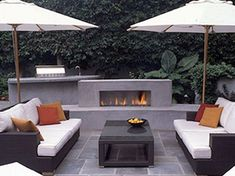 Patio Outdoor Gas Fireplace For Deck With Black Wicker Furniture Chairs Used White Cushions Above Granite Stone Floor Modern Outdoor Gas Fireplace Furniture dimensions insert components with blower chimney do it yourself ideas Modern Outdoor Fireplace, Outdoor Fireplace Designs, Fireplace Ideas, Fireplace Seating, Fireplace Shelves, Simple Fireplace, Fireplace Kitchen, Black Fireplace, Fireplace Mirror