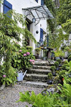 Un jardin au féminin - perron de la maison