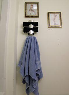 Ikea wine rack turned into bathroom towel rack!