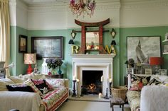 Anna Richardson's Hastings, East Sussex home. She painted the living room walls in Farrow & Ball's Arsenic (tel: 0120 287 6141, farrow-ball.com). The chandelier from Little Voice and ornate mirror glam up the otherwise laid-back scheme. The throws and cushions on the Michael Tyler sofas (tel: 01424 756675, michael-tyler.co.uk) came from an Indian market
