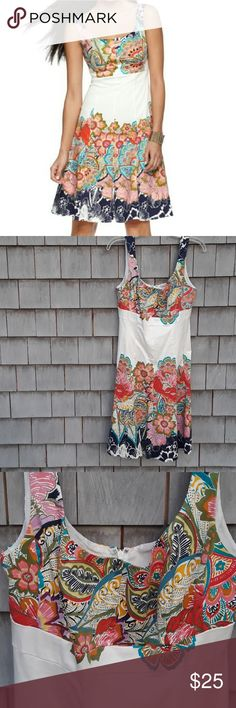 NINE WEST FIT AND FLARE DRESS Incredibly beautiful fully lined dress. Fitted thru bodice loose at skirt.fit someone 10 loosely or 12 fitted. No rips or stains. Smoke Free home. Colors or vibrant.  Great warm weather vacation dress.. Nine West Dresses Midi
