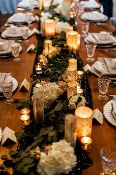 Romantic wedding reception decor idea - greenery, hydrangeas and candlelit table runner {Luma Weddings}