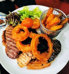 George's one and only mixed grill, consisting of three onion rings, liver, 4oz gammon, 8oz sirloin steak, chicken breast, black pudding, chunky chips aand lightly dressed side salad Chunky Chips, Mixed Grill, Black Pudding, Sirloin Steaks, Side Salad, Onion Rings, Tandoori Chicken, Grilling, Breast