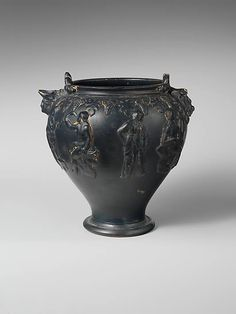 Terracotta situla (bucket), early 3rd century BCE. Etruscan. The story of Apollo and the satyr Marsyas is depicted in high relief around the vessel. Under each handle are additional reliefs that imitate treatments of this shape as they appear in metal.