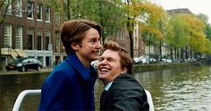 This is them in Amsterdam . This had to be one of the peaks in the book . Hazel would post this because this is her and her first love having a great time . She was excited to share that experience with him , and would like to show it with everyone else .