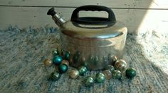 Check out this item in my Etsy shop https://www.etsy.com/listing/465470607/mid-century-whistling-chrome-tea-kettle