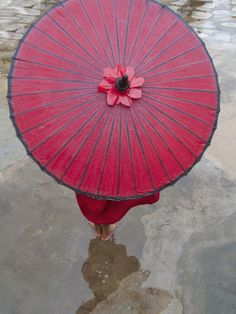 Burmese Buddhist monk umbrellas are of plain dark brown colour and not decorated.