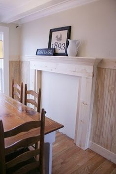 This blogger used bead board and wood to create the look of a fireplace in her dining room, since it wasn't the heat she wanted -- just the look. Not sure what she is planning to do to block out the fireplace itself...The Twice Remembered Cottage - A Cottage Transformation Journey
