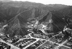 This aerial photograph was taken in 1923 and shows us the where Laurel Canyon Rd emerges from the Hollywood hills into West Hollywood. Laurel Canyon isn't the curving road in the middle of the shot, but the one trailing out of the hills on the right. Of particular interest (to me, at least) is that in the bottom right corner, we can ju-u-u-u-ust see a glimpse of Alla Nazimova's home that in a few years' time she'd turn into the Garden of Allah Hotel.
