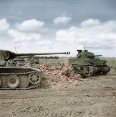 M4 Sherman tank of 24th Lancers, 8th Armoured Brigade, passing a knocked-out German PzKpfw V Panther 12th SS-HJ near Rauray, Normandy. 30 JUN 44