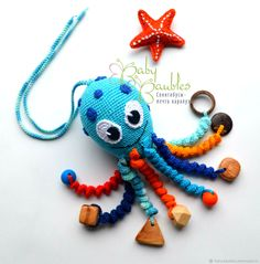 "Compre ""Octopus"" sling-toy-rattle na loja online na Fair of Masters Crochet Animal Amigurumi, Crochet Octopus, Crochet Animals, Amigurumi Doll, Crochet Dolls, Handmade Baby Gifts, Handmade Toys, Crochet Bebe, Cute Crochet"