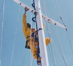Using the Mast Mate to change out a spreader light: note the safety harness this sailor is using and how the tether encircles the mast. Photo by Mast Mate