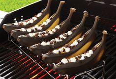 Grilled Banana Boats!  Whether you make Grilled Banana Boats with chocolate morsels and mini marshmallows (it's just indescribably amazing), Grilled Spiced Bananas, or Grilled Banana Sundaes, you'll discover a super sweet and caramelized treat that everyone at your next cookout will love. What a great way to cap off a dinner al fresco! #grilling #pamperedchefwithabbey