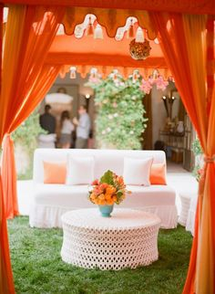 orange tents + white couches + turquoise accents // outdoor wedding lounge inspiration