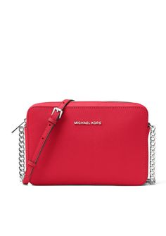 Glamorous yet simple on the outside, this crossbody opens up to a spacious interior that is effortlessly designed to keep essentials organized. Wear the extra-long strap across your chest and step out in hands-free style for the ultimate fashion-forward look. #ad #handbags #bags #michaelkors