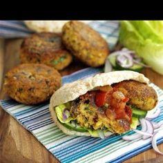 Falafel burger   Recipe Pat the chickpeas dry with kitchen paper. Tip into a food processor along with the onion, garlic, parsley, spices, flour and a little salt. Blend until fairly smooth, then shape into four patties with your hands. Heat the oil in a non-stick frying pan, add the burgers, then quickly fry for 3 mins on each side until lightly golden. Serve with toasted pittas, tomato salsa and a green salad.