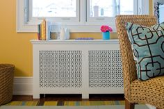 A custom-designed radiator cover conceals an unsightly unit in this newly designed home office.