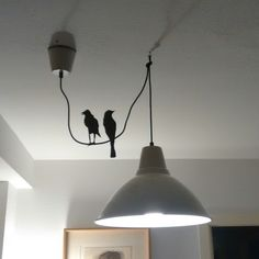 """I bought a Foto lamp and didn't cut the wire. I love """"The Birds"""" movie from Alfred Hitchcock, so I cut two black birds and glued directly to the wire."""