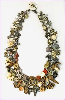 """""""Critters, a woven treasure necklace featuring over 200 different animal beads and charms made from many different materials; necklace by Robin Atkins, bead artist""""  narrative from website"""