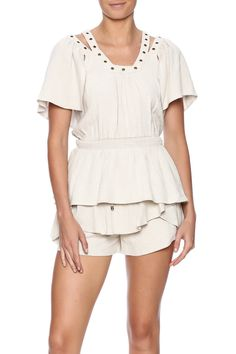 Beige woven short sleeve blouse with grommet detailing smocked waist and a square neckline.  Urban Adventure Top by Pinkyotto. Clothing - Tops - Short Sleeve Clothing - Tops - Blouses & Shirts Nolita Manhattan New York City Boston Massachusetts