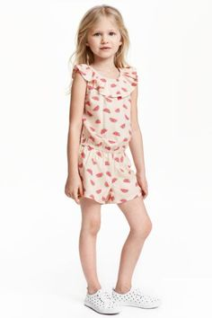 Patterned playsuit: Playsuit in a soft, patterned viscose weave with elastication and a frill at the top, an elasticated seam at the waist and short legs.