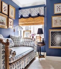 Pretty blue color palette! Like the fabric on daybed, valance & chair. Great art display!