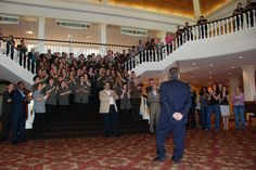 Fun photo at Gaylord Hotels where a meeting planner was welcomed with a surprise STAR (employee) ovation in the Magnolia Lobby at Opryland