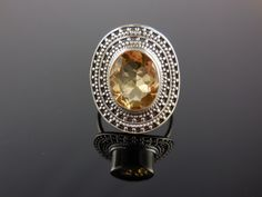 Made with 10x12mm oval faceted citrine quartz gemstone, sterling silver bezel and wire. Size 7.0