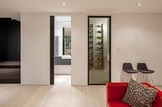 dark fry reglet floor reveal with dark reveal on jamb and header and dark door framing.