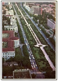 Krasnodar grows more beautiful from year to year. When new avenues are laid and new buildings go up, the city planners do not forget to leave room for gardens, trees and flower beds. From Sputnik Digest of Soviet Press, May 1974.