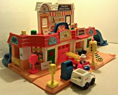Vintage Fisher Price Little People Main Street play set.