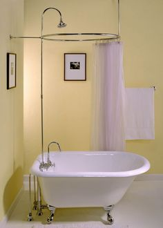 I am so obsessed with claw tubs right now, it's not even funny. And I found this small one that would fit our master bathroom. If it were just me, I'd install it in a heartbeat. But alas, I have this tall husband hanging around here ... :)