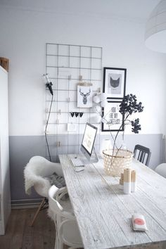 great workspace with a mix of clean walls, comfy chairs, practical storage and a nice big table.