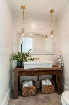 Powder room featuring a salvaged wood console table upcycled into a washstand fitted with a large ve&; Powder room featuring a salvaged wood console table upcycled into a washstand fitted with a large ve&; C B cbsugarandspice […] room storage combo Modern Coastal, Coastal Farmhouse, Farmhouse Vanity, Coastal Style, Farmhouse Kitchens, Coastal Decor, Modern Farmhouse Powder Room, Farmhouse Furniture, Eclectic Decor