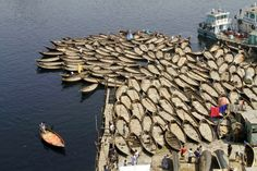 Boats are anchored to block the traffic on the banks of the River Buriganga in Dhaka, Bangladesh.