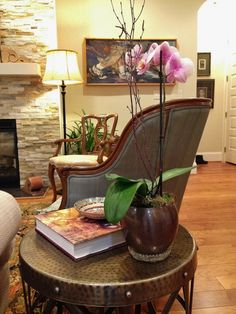 A close up on this pretty side table vignette, complete with orchid and good reads!
