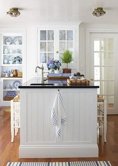 White kitchen with blue accents - I like the beadboard on the island Country Kitchen, New Kitchen, Kitchen Decor, Kitchen Island, Nautical Kitchen Backsplash, Kitchen Cabinets, Kitchen Floors, Kitchen Fixtures, Room Kitchen