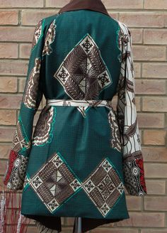 A unique three African print jacket. This stylish jacket is loose fitting, fully lined to keep you warm and very comfortable Jacket has no closure( Belt included), big raglan long sleeves and waterfall collar. Available in 5 sizes SMALL- (8-10) uk sizes MEDIUM- (12-14) LARGE (16-18) X-LARGE (20-22) XX-LARGE (24-26) Can be made in other prints please enquire to see what prints we have in stock.