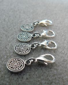 Easy stitch markers for crochet or knitting made with lobster claw claps, jump rings and little charms.