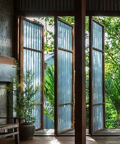 NISHIZAWAARCHITECTS completes house in vietnam with rotating corrugated metal panels NISHIZAWAARCHITECTS has completed a shared house in vietnam's southern an giang province, which has been constructed using sheets of corrugated metal. Thai House, Tropical House Design, Tropical Houses, Bamboo House Design, Container Design, Metal Panels, Interior And Exterior, Architecture Design, Tropical Architecture