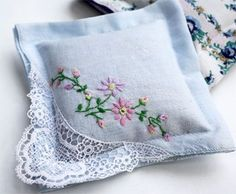 vintage embroidered handkerchiefs filled with lavender. Saw something similar in a store this weekend with ribbons to hang over a bedpost or door knob. Great idea for my grandmothers needle work that's sitting in a drawer.    http://www.skiptomylou.org/2010/04/21/handkerchief-sachets/