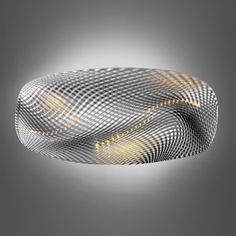London designer Ross Lovegrove has designed three lights for Italian brand Artemide. Cosmic Angel (above) is an undulating form derived from air rippling across fabric, which can be lit from above or below. The surface of the wall-mounted version (above and below) is covered in LEDs, allowing the colour of light emitted to be altered.