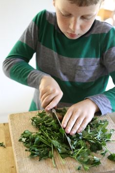 Kids in the kitchen. Chopping vegetables.