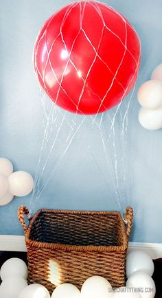 Hot Air Balloon Photobooth & Party Details #kids #children #birthday…cute with balloons mimicking clouds.