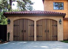 wooden garage doors on spanish style house.