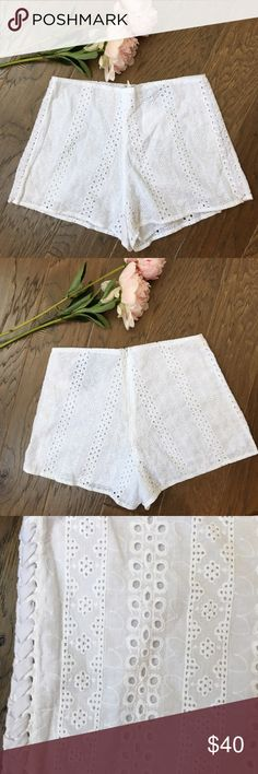 💥 NWT Eyelet Lace Soft Shorts NWT eyelet lace soft shorts. Perfect for hot summer days! Cute lace up detail on the sides. Zipper in the back. 100% cotton. Length is about 11 inches and waist is about 25 inches. LF Shorts