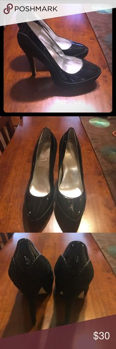 Calvin Klein pumps Size 7 High-heeled platform style pumps.  Size 7 in perfect condition. Patent leather and textured snake skin detail. 4 inch heel. Calvin Klein Shoes Heels