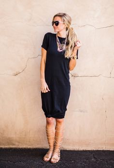 Style your t-shirt dress with gladiator sandals and a statement necklace.