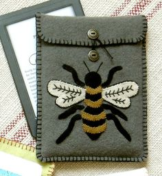 Felted wool Kindle cover -- Bee Butterfly pattern by Black Mountain Needleworks.