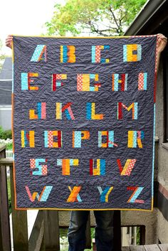 I'm not a huge fan of alphabet quilts generally, but this one is great. Love the circular quilting pattern as well!
